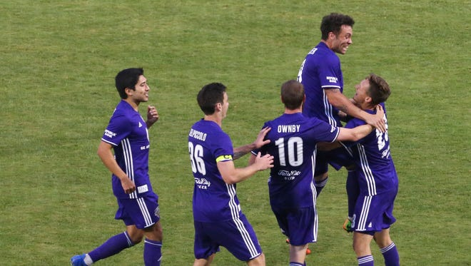 Louisville FC's Cameron Lancaster (9) leaps into the arms of teammate Richard Ballard (23) after Ballard scored against Charlotte Independence during their game a Slugger Field.June 7, 2017