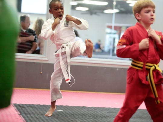 Aiden Coleman, 7, practices karate moves in Lafayette March 20, 2017.