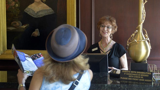 Jackie Griffith from behind the front desk at The Marshall House helps a guest navigate the best tourist spots downtown.According to the Georgia Department of Labor, Chatham, Bryan and Effingham counties ended July with 174,800 jobs, including 600 jobs gained in hospitality industry