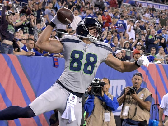 Seattle Seahawks' Jimmy Graham spikes the ball after