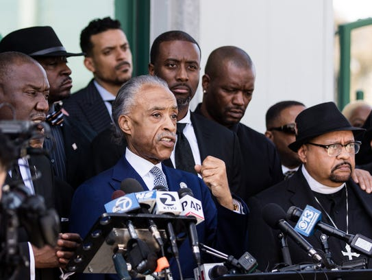 The Rev. Al Sharpton talks to the media after the funeral