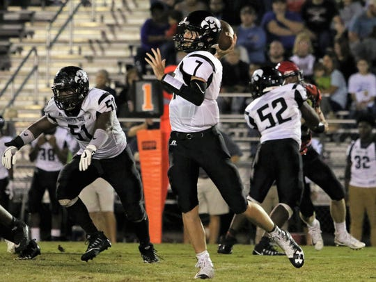 South Side's Tyler Carver (7) throws the ball against