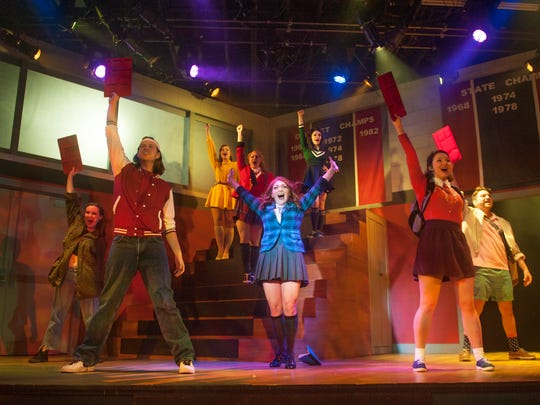 Cailene Kilcoyne (center) of San Diego, California, who portrays Veronica Sawyer in 'Heathers The Musical' at the Eagle Theatre in Hammonton, takes part in a dress rehearsal.