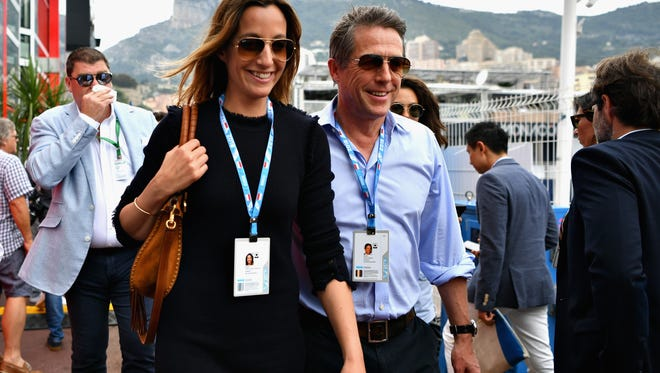Actor Hugh Grant and his wife, TV producer Anna Eberstein, at the Monaco Formula One Grand Prix at Circuit de Monaco on Sunday.