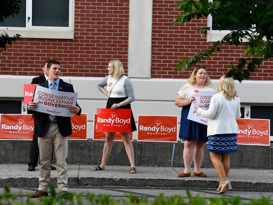 Randy Boyd supporters greet gubernatorial forum attendees outside Allen Arena at Lipscomb University Tuesday, May 15, 2018, in Nashville, Tenn.