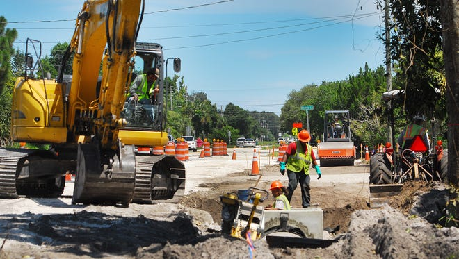 Construction crews work on a turning lane into Tropical Elementary on South Courtenay Parkway on Merritt Island. The proposed county budget has more money for road repair and maintenance, but finding money for road network expansion remains a challenge.