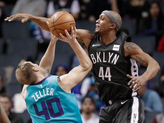 Brooklyn Nets' Dante Cunningham (44) tries to block a shot by Charlotte Hornets' Cody Zeller (40) during the first half of an NBA basketball game in Charlotte, N.C., Thursday, March 8, 2018. (AP Photo/Chuck Burton)