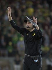November 14, 2015; Stanford, CA, USA; Oregon Ducks head coach Mark Helfrich instructs during the fourth quarter against the Stanford Cardinal at Stanford Stadium. The Ducks defeated the Cardinal 38-36. Mandatory Credit: Kyle Terada-USA TODAY Sports