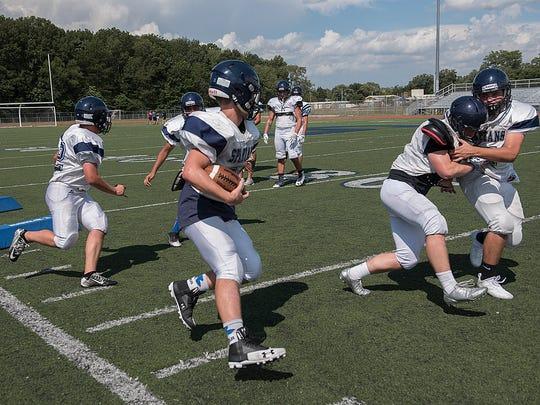 Football practice at Livonia Stevenson.