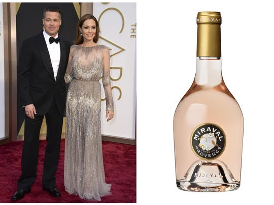 This combination photo shows Brad Pitt and Angelina Jolie at the Oscars in Los Angeles on March 2, 2014,, left, and a bottle of their Chateau Miraval Cotes de Provence Rose.