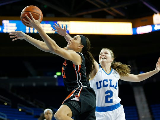 Oregon State guard Gabriella Hanson, left, goes to the hoop past UCLA Bruins guard Kari Korver, right, during the first half of an NCAA college basketball game, Monday, Jan. 4, 2016, in Los Angeles.