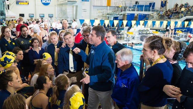Michigan football coach Jim Harbaugh gives Michigan women's swimming and diving team a pep talk ahead of Saturday's final competition at Canham Natatorium.
