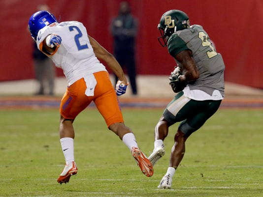 Baylor wide receiver KD Cannon (9) pulls in a touchdown pass as Boise State cornerback Jonathan Moxey (2) defends during the first half of the Cactus Bowl NCAA college football game, Tuesday, Dec. 27, 2016, in Phoenix. (AP Photo/Rick Scuteri)