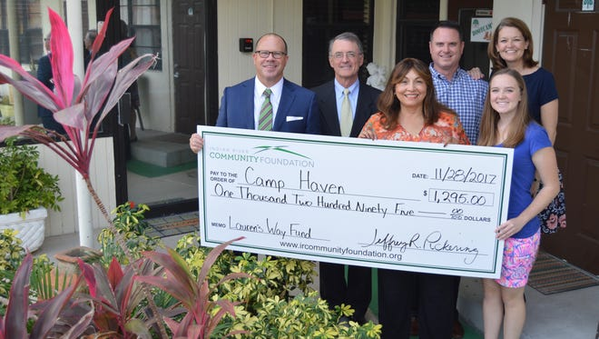 Lalita Janke of Camp Haven, third from left, accepts a check from, front row, Jeff Pickering, Scott Alexander, and Lauren Weaver. Pictured in back are Ryan and Melissa Weaver.
