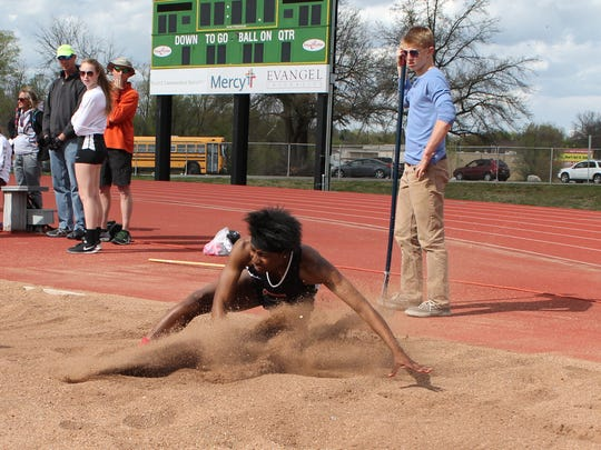 Central senior Jaslym Williams lands in the long jump