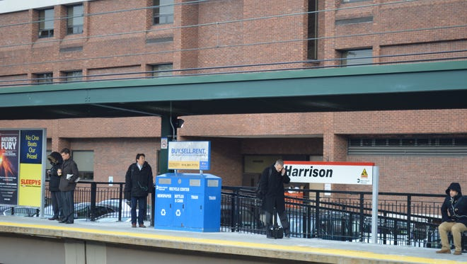 Seen behind the southbound train platform is Harrison Town Hall. Town officials oppose including affordable housing in the MTA's 143-unit apartment complex at the Harrison train station.