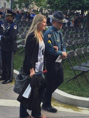 Robynn Dunn arrives at a candlelight vigil in Washington, D.C., on Wednesday.