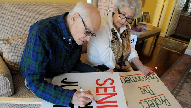 Pequannock seniors Nat Arkin, 90, and Jackie Arkin, 84, work on protest signs Thursday, January 19, 2017, for a planned demonstration at Pequannock City Hall this Saturday, January 21, 2017.