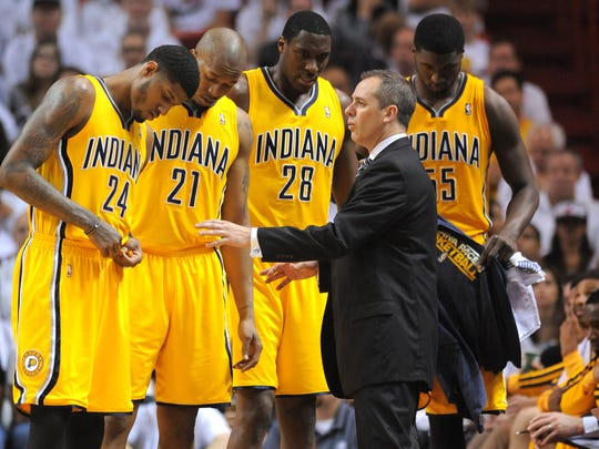 Pacers head coach Frank Vogel address his players (Left to Right)  Paul George, David West, Ian Mahinmi and Roy Hibbert.    Indiana Pacers vs. Miami Heat in game two of the Eastern Conference Finals Friday, May 24, 2013, at the American Airline Arena in Miami FL.  Matt Kryger / The Star.