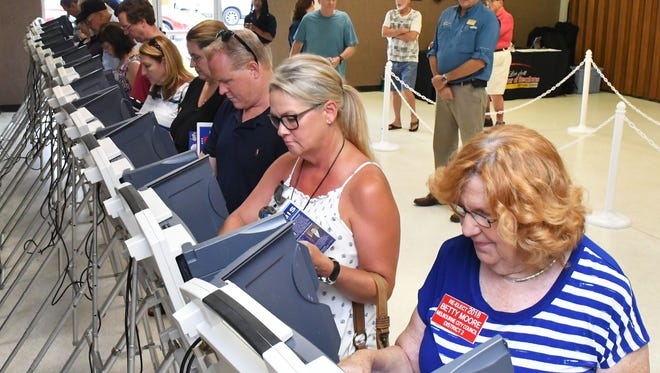 Attendees cast their ballots in last Sunday's straw poll at the Brevard County Republican Party's picnic at the Melbourne Auditorium.