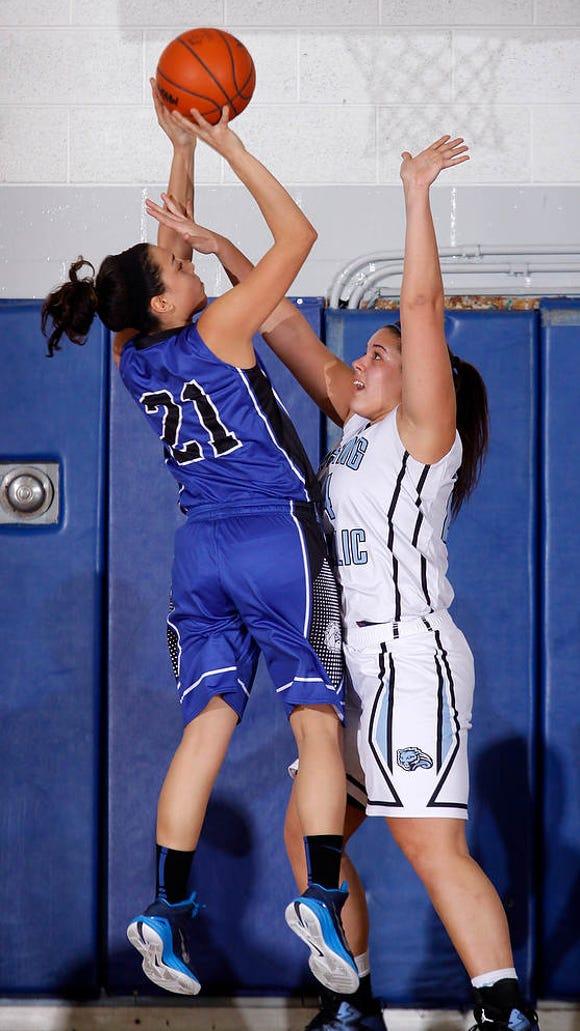 Ionia's Jaylynn Williams (21) shoots against Lansing