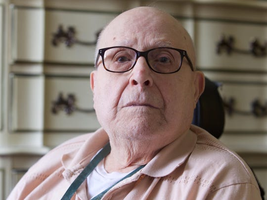 Pat Testa in his room at his assisted-living home.