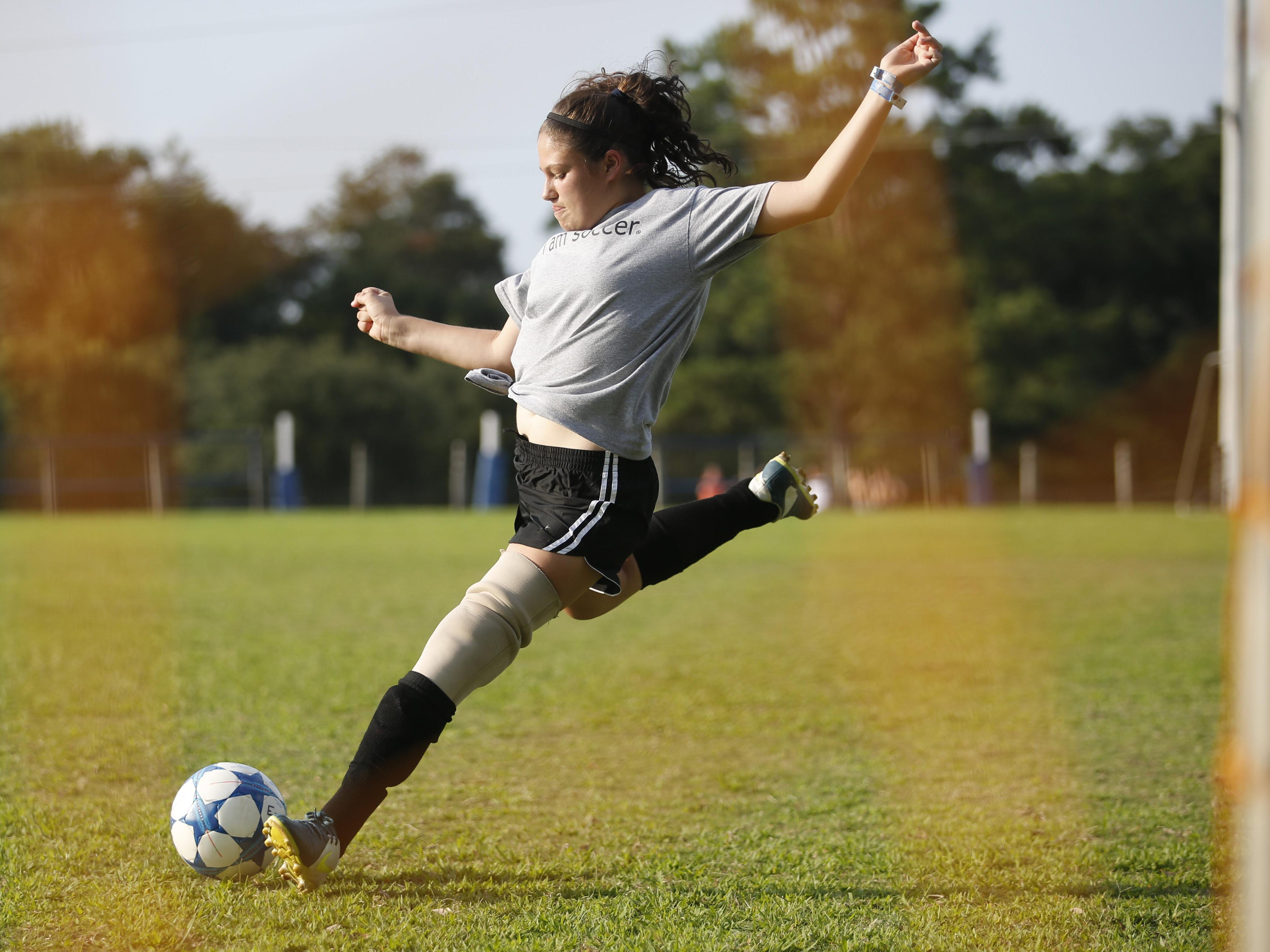 Erica Silvey, 13, who has been playing soccer since she was 5 on a prosthetic leg, takes a shot on goal before practice with her new summer league team at Tom Brown Park on Tuesday, July 7, 2015.