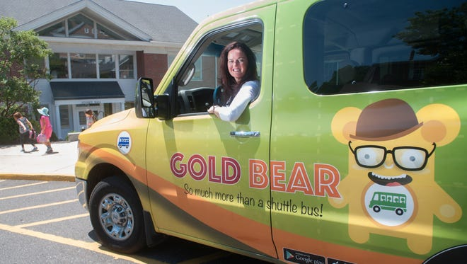 Justine Zeroski, CEO of Gold Bear, a Moorestown based company that provides safe transportation for children aged five to 17 in Burlington and Camden counties, sits in one of her shuttle buses in front of Moorestown Friends School.