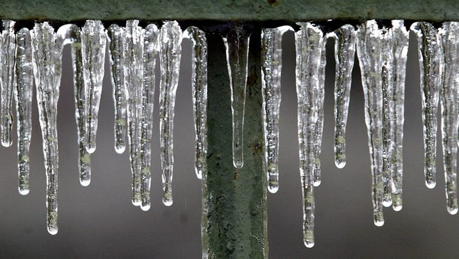 Ice coats a iron fence during the 2005 ice storm.