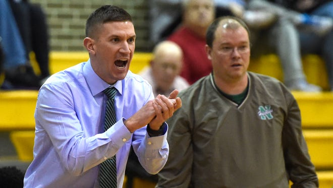 North girls' basketball coach Tyler Choate, encouraging his team, has guided the Huskies to a 40-17 record in his third season.