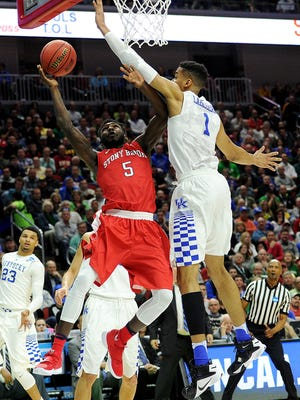 Mar 17, 2016; Des Moines, IA, USA; Stony Brook Seawolves guard Ahmad Walker (5) shoots the ball against Kentucky Wildcats forward Skal Labissiere (1) during the first half in the first round of the 2016 NCAA Tournament at Wells Fargo Arena. Mandatory Credit: Steven Branscombe-USA TODAY Sports