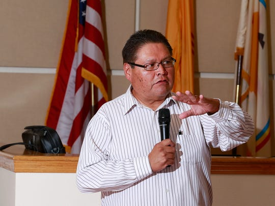 Carl Smith, the executive director of the Navajo Nation Division of Community Development, speaks on Wednesday during a meeting at the San Juan Chapter house.