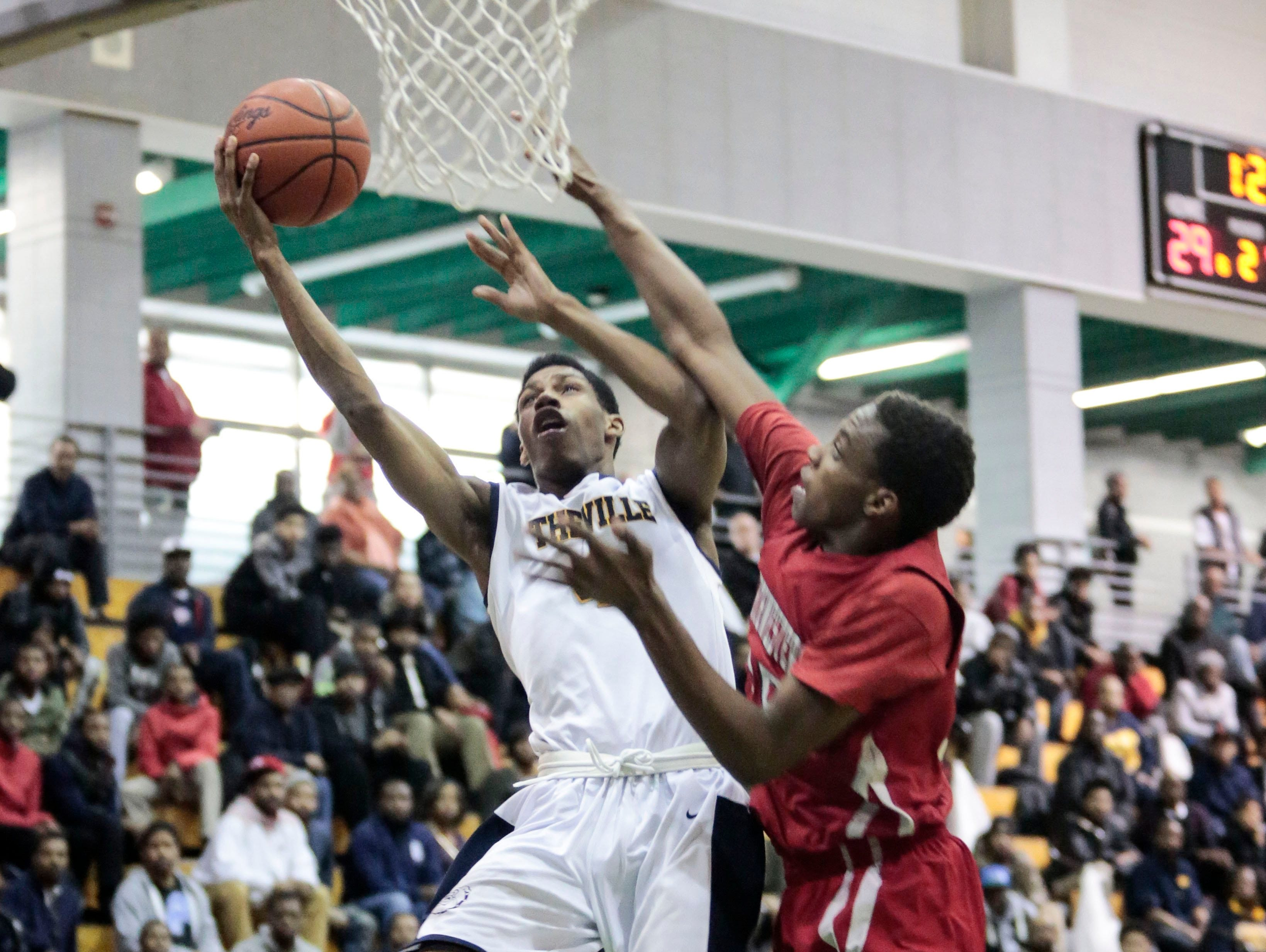 East English Village's Greg Elliott (3) goes up for the shot through the defense during the Northwestern vs. East English Village boys' basketball semifinals on Friday, Feb. 12, 2016 at Cass Technical High School in Detroit. East English Village beat Northwestern 71-70.