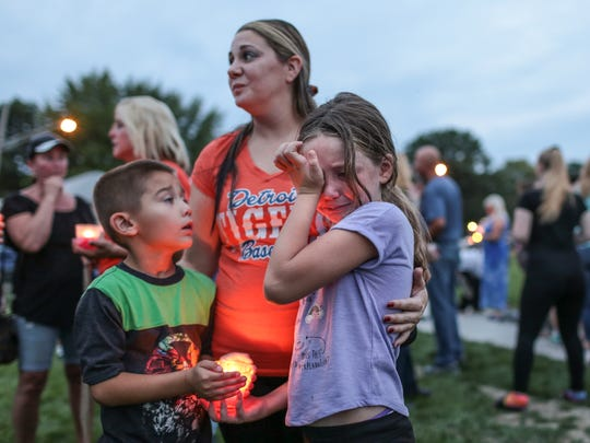 Bella Martin, 6 of Dearborn Heights, wipes away tears