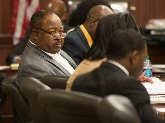 Joe Whitt, Sr., looks on during a ASU Board committee