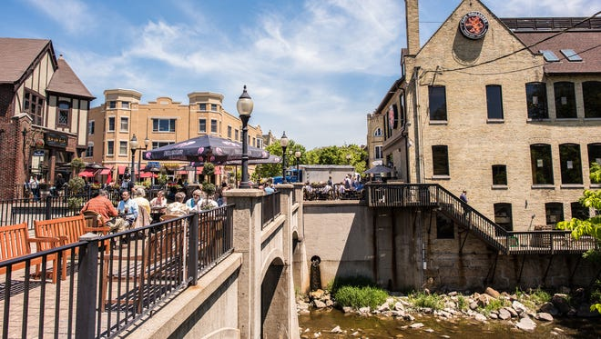 The pedestrian bridge over the Menomonee River in Wauwatosa, which is Cafe Hollander's patio, will be the setting for a Biers of Summer dinner on July 20.
