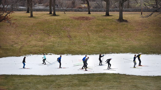 Cathedral/Sartell Nordic Ski Team members practice Friday on a patch of man-made snow at Riverside Park in St. Cloud.