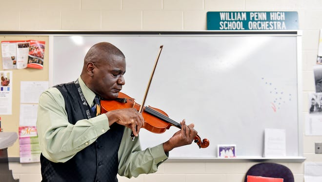 William Penn music teacher Don Carn plays a violin made by former student Chris Kurz Thursday, Jan. 12, 2017, at William Penn. Valedictorian of his class at William Penn, Chris Kurz, 27, dropped out of Penn State to study violin-making in Cremona, Italy. With his extended visa expiring in April, Kurz is now at a crossroads as to whether, where and how he should pursue his career.