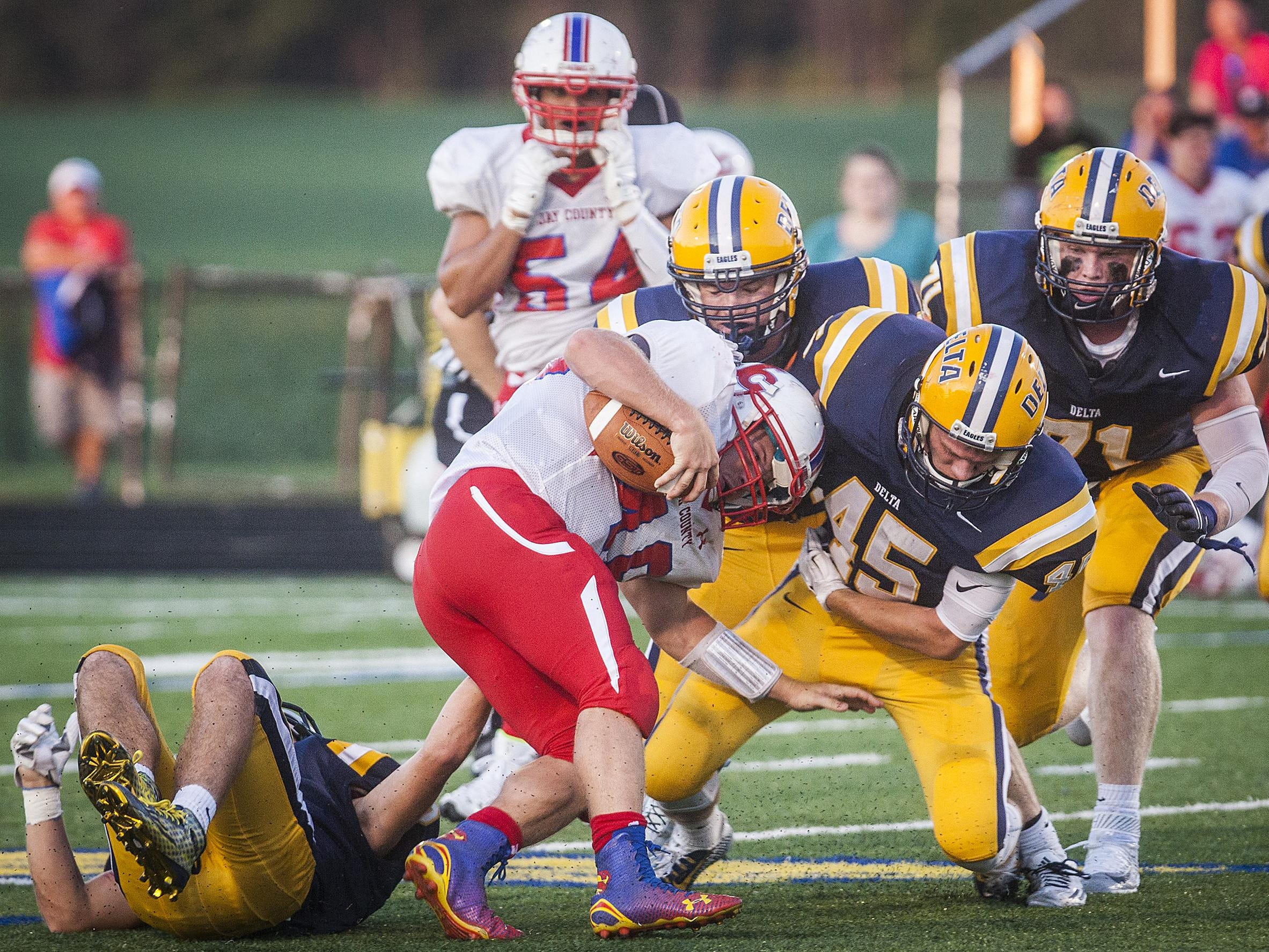 Kaleb Slaven and Kalib White (45) tackle Jay Count's Levi Hummel in the Eagles' Week 1 contest.