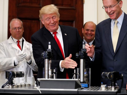 President Donald Trump, beside Wendell P. Weeks, right,