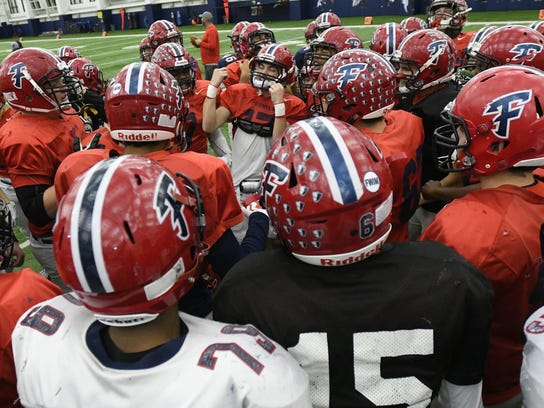 Livonia Franklin gets fired up in the huddle after