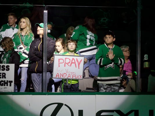 A young fan holds a sign in the stands before warm ups for an NHL hockey game between the Vegas Golden Knights and Dallas Stars in Dallas, Friday, Oct. 6, 2017. (AP Photo/LM Otero)