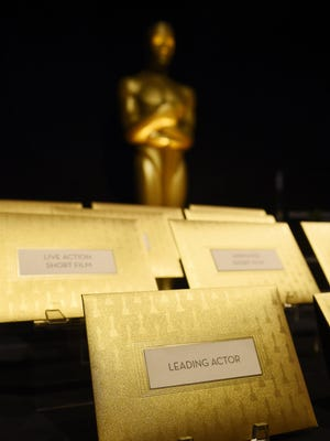 Gold Oscar envelopes designed by Marc Friedland are displayed at the 88th Academy Awards Governors Ball Press Preview.