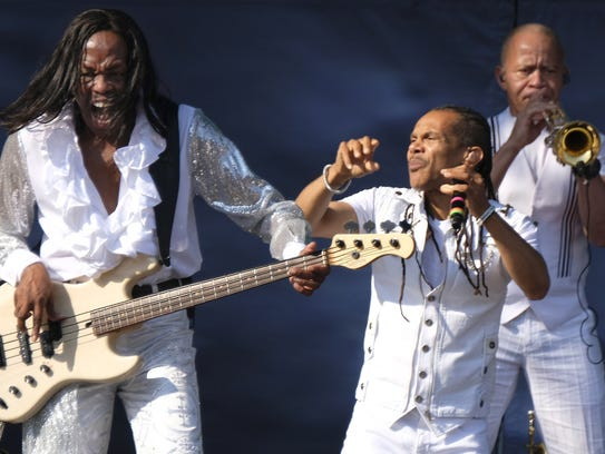 Verdine White, left, with Earth, Wind & Fire perform