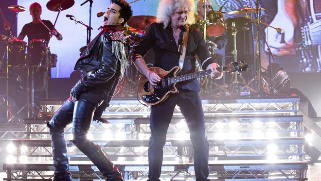Adam Lambert, left, will front Queen, featuring guitarist Brian May, for a 24-date North American tour this summer.