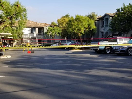 Yellow tape cordons off an area of apartments in the