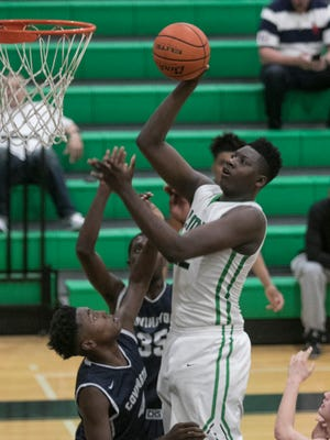 Jaden Edwards shoots over Keejohn Batiste in the second quarter as Lafayette hosts Covington in the first round of the playoffs on Friday night at Lafayette High Feb. 24, 2017.