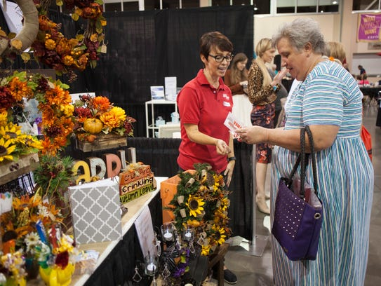 St. George women browse vendor booths during the What