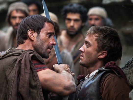 Clavius (Joseph Fiennes, left) and Lucius (Tom Felton)