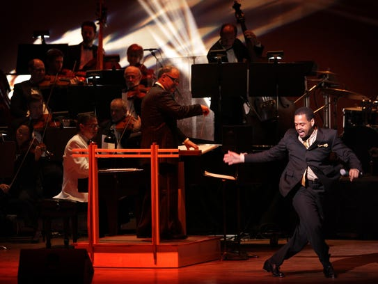 Dancer Ted Louis Levy performs with Jeff Tyzik conducting
